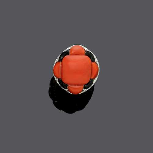 CORAL, ONYX AND DIAMOND RING.