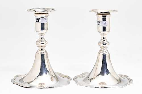 PAIR OF SMALL SILVER-PLATED CANDLESTICKS
