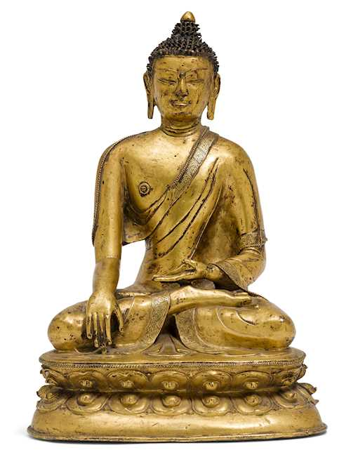 A GILT COPPER ALLOY FIGURE OF SHAKYAMUNI.