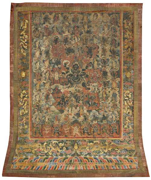 A FINE THANGKA OF SADBHUJ MAHAKALA AND HIS RETINUE.