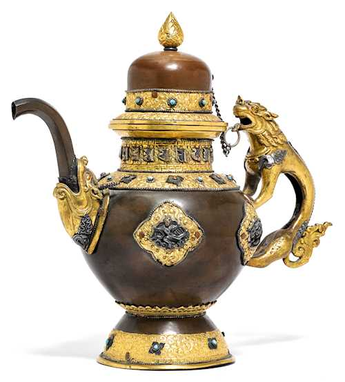 A FINE PARCEL-GILT COPPER TEAPOT.