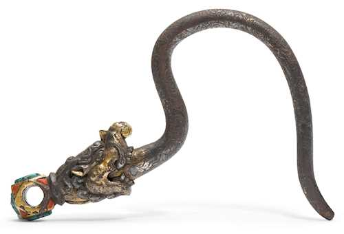 A RARE IRON RITUAL HOOK WITH MAKARA HEAD.