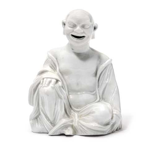 SEATED PORCELAIN FIGURE