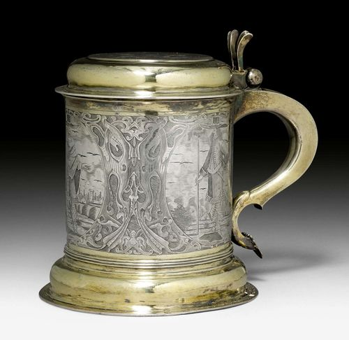 TANKARD WITH COVER,probably Germany 17th century. With later Viennese marks. Parcel gilt. Engraved with 3 cartouches and representations of gentlemen before city views. The cover with engraved coat of arms and crest. H 20cm, 1185 g.