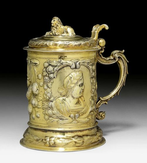 SILVER-GILT TANKARD WITH COVER,marked Danzig, 2nd half of the 17th century. Maker's mark: PHL. Chased and embossed. With medallion with Emperor between fruit clusters. H 20 cm, 1025 g.