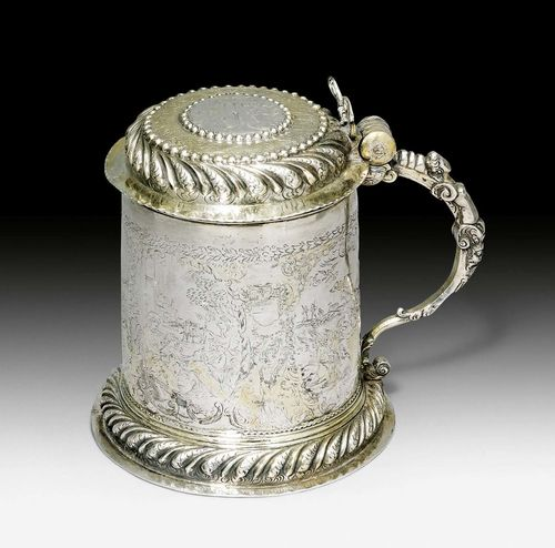 TANKARD WITH COVER,probably Germany circa 1700. With maker's mark. Parcel gilt, embossed, chased and engraved. Finely engraved on all sides with Nativity depictions. The lid with engraved medallion with the Annunciation. Curved handle with herm and angel thumbpiece (damaged). H 15 cm, 440 g.