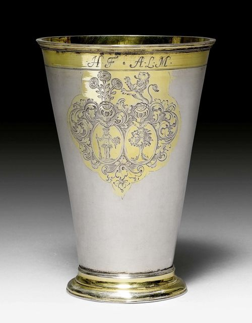 TALL BEAKER,unmarked. Baltic, early 18th century. Parcel gilt. With engraved matrimonial coat of arms and engraved initials HF and ALM. H 17 cm, 361 g.