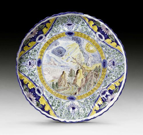 FAIENCE PLATTER,Nuremberg circa 1720-30. Polychrome painted, probably by G.F. Grebner or Justus Alexander Gluer, with New Testament scene of 'Jesus on the Mount of Olives'. Without mark. Inventory number of the Germanisches Nationalmuseum in Nuremberg in red H.G. 2309. D 31cm