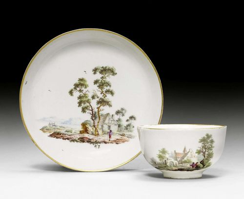 CUP AND SAUCER WITH LANDSCAPE DECORATION,Zurich, circa 1775. Underglaze blue mark Z and 2 dots. Slight chipping to foot edges, gilding somewhat rubbed.