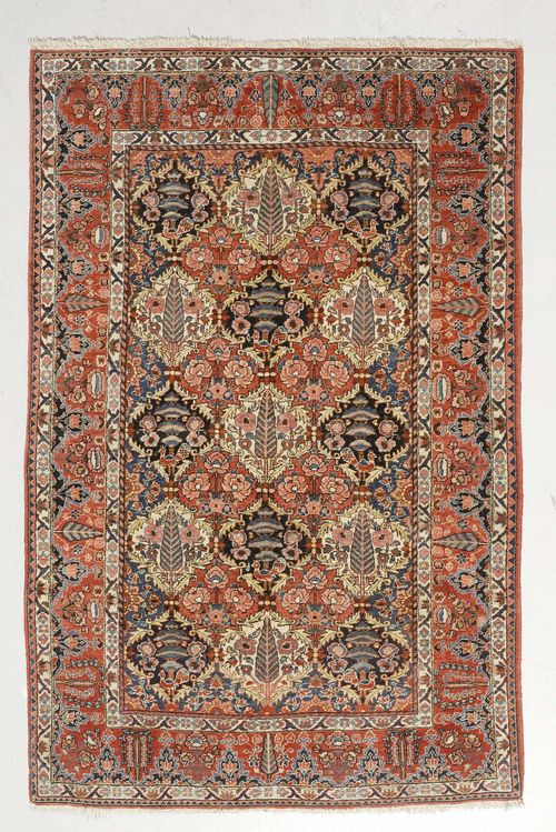 BACHTIAR old.Honeycomb patterned central field with plant motifs, red edging, 140x210 cm.