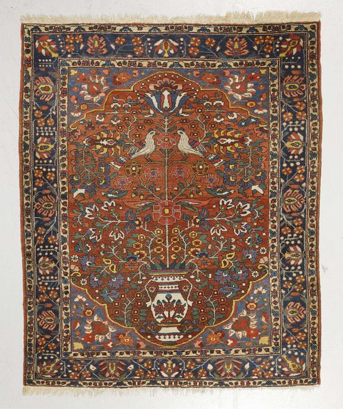 BACHTIAR old.Red ground with blue corner motifs, patterned with vases and birds, blue border with trailing flowers, 168x197 cm.