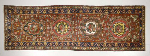 BACHTIAR antique.Red ground with four floral medallions, blue border, 135x445 cm.