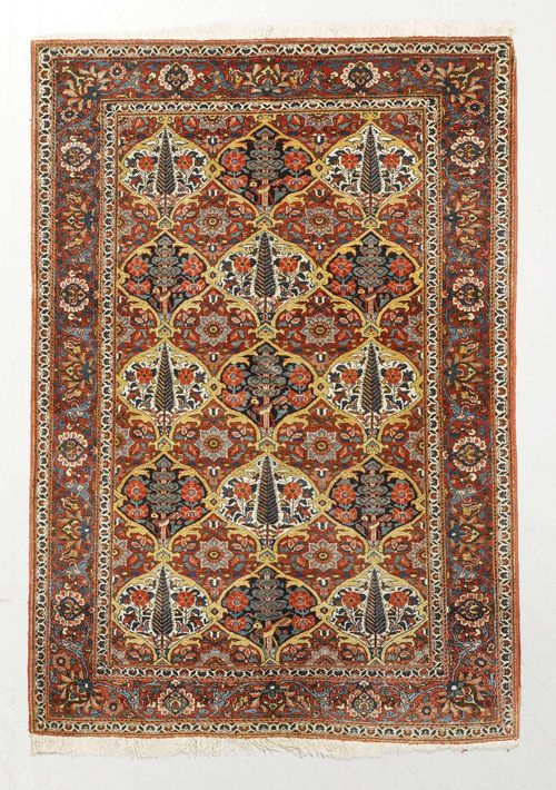 BACHTIAR antique.Central field patterned with colourful plant motifs, red border with trailing flowers, 145x200 cm.