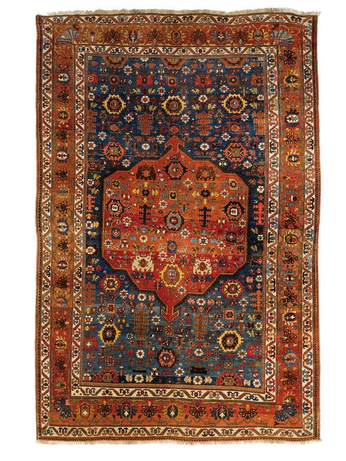 BIDJAR antique.Blue ground with dusky pink central medallion, patterned with star motifs, wide border in dusky pink with trailing flowers, 235x335 cm.