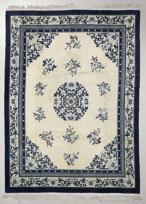 CHINA old.Beige ground with a central medallion. The entire carpet is patterned with floral motifs. Beige edging. Slight wear. 245x305 cm.