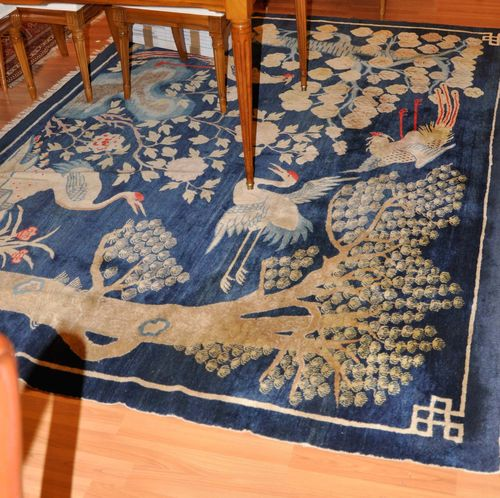 CHINA antique.Blue ground, patterned with trees and birds, 190x270 cm.
