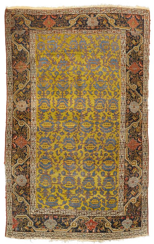 FERAGHAN antique.Yellow ground with stylized flowers in blue, black border with trailing flowers, strong signs of wear, 130x205 cm.
