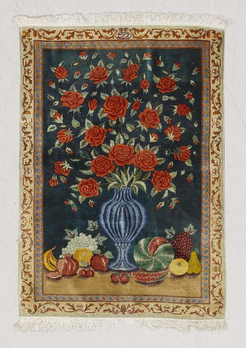 GHOM SILK PICTORAL CARPET.Blue ground with a vase and fruit, beige border, 67x97 cm.