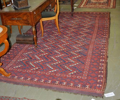 BESHIR antique. The red ground with geometric patterning. Some wear, 187x320 cm.