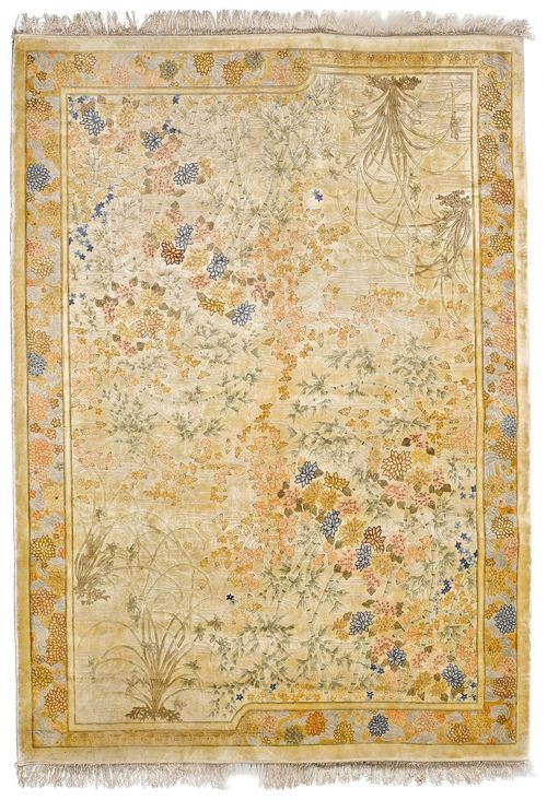 CHINESE SILK old.The beige ground is patterned throughout with plant motifs in delicate pastel colours. With a light blue border. Some light wear, 243x335 cm