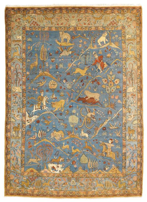 GHOM old.The blue central field is patterned throughout with hunting motifs in delicate pastel colours. Slightly worn, 237x303 cm.