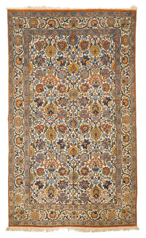 GHOM old.The white ground is patterned throughout with flowers and palmettes in harmonious colours. With a white border. Slightly worn, 130x210 cm.