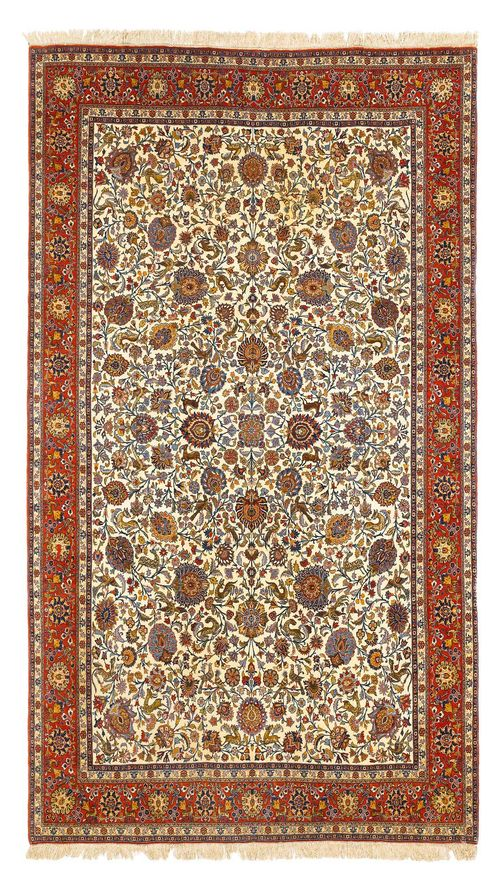 GHOM old.The white central field is patterned throughout with trailing flowers, palemttes and animal motifs. With a red border. Stained, otherwise good condition, 210x330 cm.