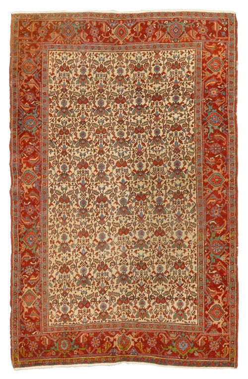 HERIZ antique. With a white ground decorated throughout with stylised plants and a red border. With areas of heavy wear, 140x190 cm.
