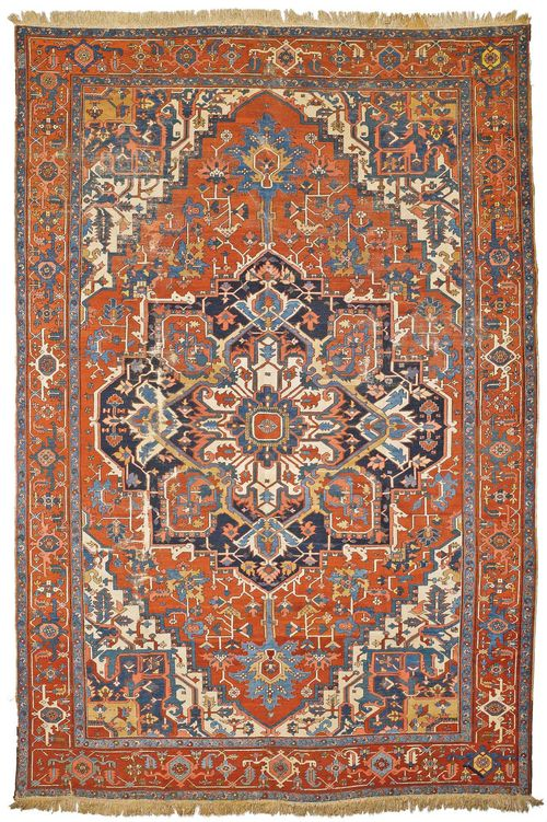 HERIZ SERAPI antique. With a large central medallion on a red ground with white corner motifs, patterned in the typical manner and with a red border. With areas of heavy wear, 293x405 cm.