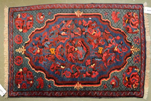 KARABACH old.The blue ground has a large central medallion and geometric patterning in bright colours. Good condition, 85x115 cm.