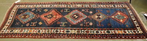 KASAK old.With a dark blue ground, five medallions and a white border. Good condition, 105x230 cm.