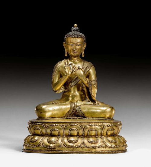A GILT COPPER FIGURE OF BUDDHA DIPANKARA. Tibet, 15th c. Height 31.5 cm. Consecration plate replaced.