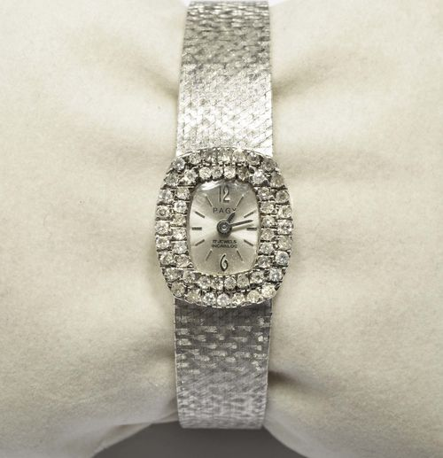 DIAMOND LADY'S WRISTWATCH, PAGY, 1960s. White gold 750, 43g. Tonneau-shaped case with diamond lunette weighing ca. 0.70 ct. Silver-coloured dial with applied indices and baton hands, signed Pagy. Hand winder. Satin-finished Milanaise band. L 18 cm.