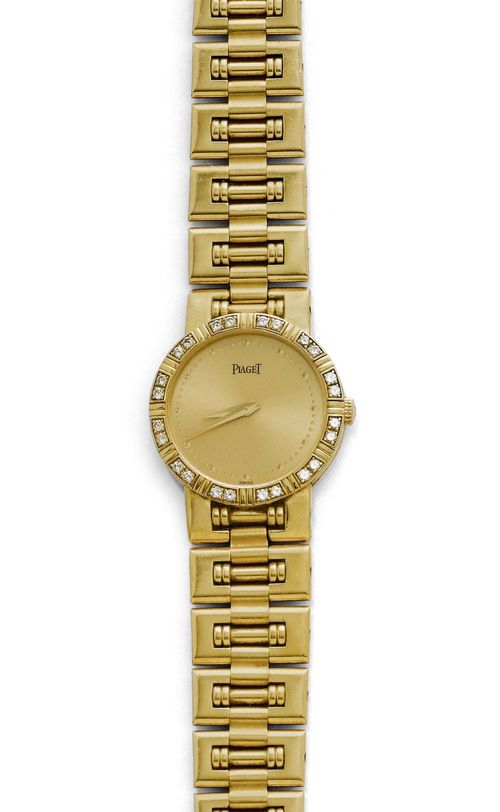 DIAMOND LADY'S WRISTWATCH, PIAGET, 1990s. Yellow gold 750, 63g. Ref. 80564K81. Flat, round case No. 655665 with brilliant-cut diamond lunette. Gold-coloured dial with dot indices and gold-coloured hands. Quartz movement No. 220307, Cal. 8P2. Does not run, movement needs to be replaced. Gold band with rectangular fantasy links, L ca. 18 cm. D 22 mm.
